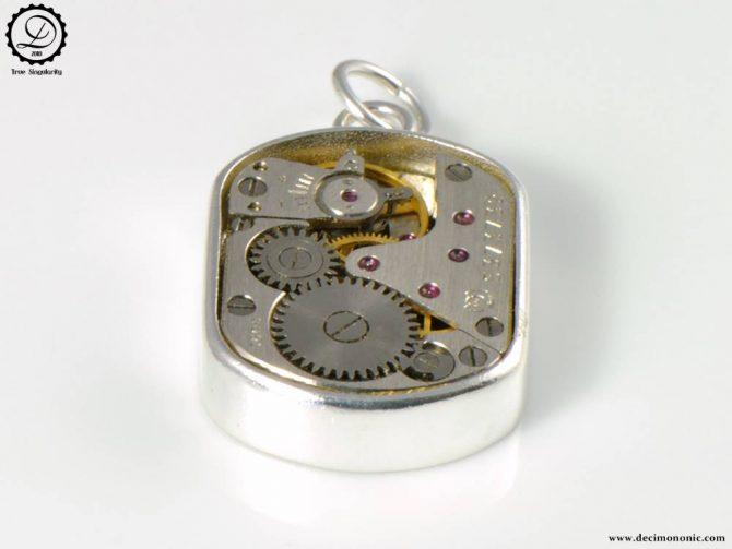 Beta Charm by Decimononic - Steampunk pendant with vintage watch movement